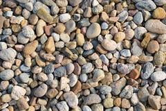 小河岩石背景 库存图片