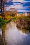 小泥泞的河 库存图片
