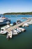 小渔船被栓对码头 免版税图库摄影