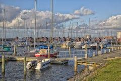 小游艇船坞在丹麦在一多云天 免版税图库摄影