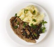 小牛肉一片无骨的肉膳食从上面 免版税库存照片