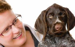 小狗和妇女 免版税图库摄影