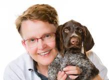 小狗和妇女 免版税库存照片