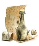 小瓶在白桦树皮,白色背景的白桦树皮 免版税图库摄影