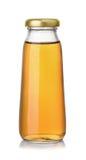 小瓶苹果汁 免版税库存图片