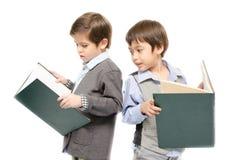 小男孩一起阅读书在白色背景 图库摄影