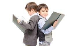 小男孩一起阅读书在白色背景 库存图片