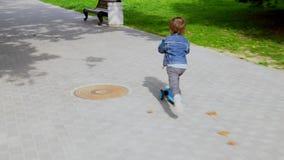 小男孩乘坐滑行车 影视素材