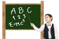 小男孩假装作为教育的专业老师 免版税库存照片