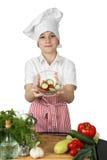 小男孩厨师拿着碗沙拉 免版税库存图片