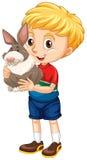 小男孩和灰色兔子 免版税库存图片