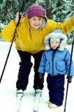 小男孩和老妇人在冬天森林里 库存图片