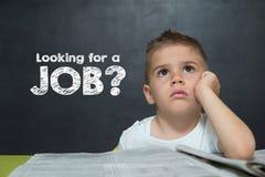 小男孩喜欢与寻找工作的文本的一个商人 免版税库存照片