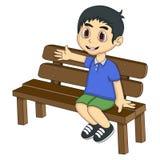 小男孩坐长凳动画片 图库摄影