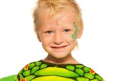 小男孩接近的画象龙服装的 免版税图库摄影