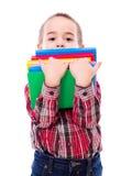 小男孩运载的书 库存图片
