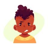 小男孩面孔,翻倒,迷茫的表情 库存照片