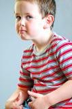 小男孩顽固的家伙神色 免版税库存照片