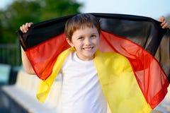 小男孩-德国全国橄榄球队爱好者 免版税库存照片