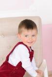 小男孩画象扶手椅子的 免版税库存图片
