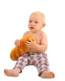 小男婴用大面包,隔绝在白色背景 免版税库存图片