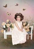 小的公主和蝴蝶 图库摄影