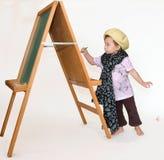 小的女孩绘画 库存图片