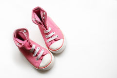 小的女婴鞋子 免版税库存照片