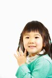 小的日本女孩微笑 免版税库存照片
