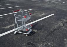 小的购物车放弃了 免版税库存图片