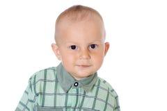 小的滑稽的男婴微笑特写镜头画象 免版税库存照片