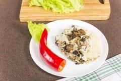 小米粥用蘑菇 免版税图库摄影