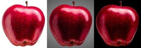 小组在另外背景的美味红色苹果 库存图片