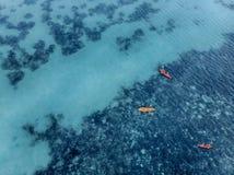 小组在镇静水的3艘皮船 库存照片