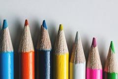 小组白色表面上的多彩多姿的铅笔 免版税库存图片