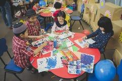 小组逗人喜爱的小的幼儿园哄骗图画 库存图片