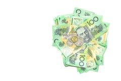 小组100美元澳大利亚人注意澳大利亚金钱堆和硬币在白色背景的 免版税图库摄影