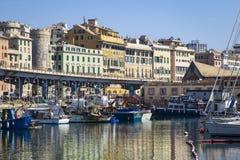 小船在旧港口,热那亚停泊了 免版税库存照片