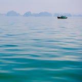 小船在蓝色海 免版税图库摄影