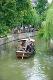 小船在运河供以人员在朱家角 免版税库存照片