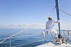 小船弓风帆前辈妇女 库存图片
