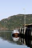 小船捕鱼被停泊的码头 免版税图库摄影