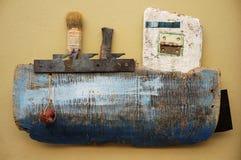 小船捕鱼设计缩放比例 库存图片