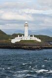 从小船看见的苏格兰的灯塔 免版税库存照片