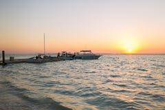 小船被停泊对码头在日落 库存图片