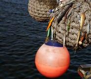 小船防御者和渔诱剂 免版税库存图片