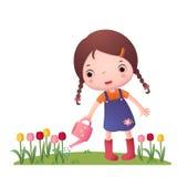 小逗人喜爱的女孩浇灌的花 库存图片