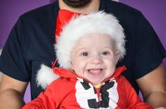 小逗人喜爱的微笑的男婴 库存照片