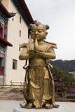 小金人和玉女孩-铜雕塑 库存图片