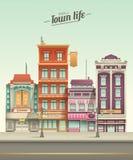 小镇与减速火箭的颜色的街道视图 库存照片